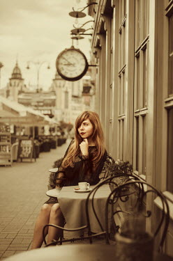 Svitozar Bilorusov Young woman sitting at table of outdoor cafe Women