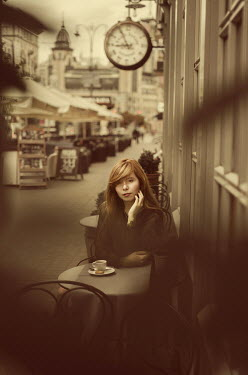 Svitozar Bilorusov Young woman sitting at table of outdoor cafe