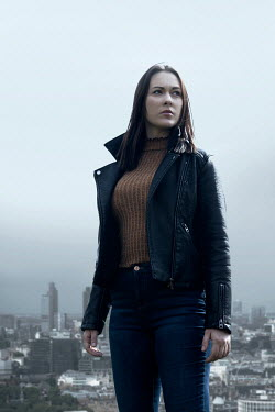 Miguel Sobreira Woman Leather Jacket Against Cityscape