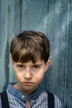 Galya Ivanova Portrait of boy by blue wall