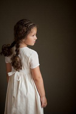 Kerstin Marinov Girl in white dress with plaited hair