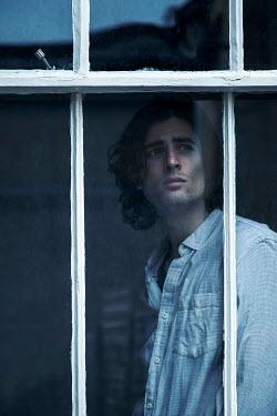 Miguel Sobreira MAN INDOORS WATCHING AT WINDOW Men