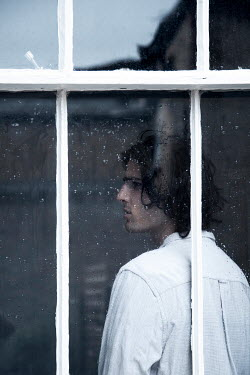 Miguel Sobreira MAN WITH DARK HAIR INDOORS BY WINDOW Men