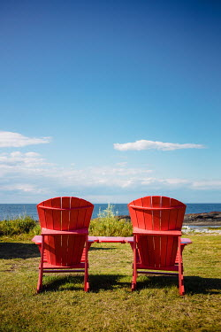 Isabelle Lafrance Red Adirondack chairs by sea Miscellaneous Objects