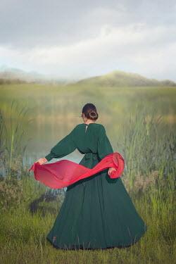 Joanna Czogala Young woman in Edwardian dress by lake
