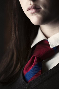 Robin Macmillan Close up of tie on girl's school uniform