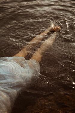Greta Larosa WOMAN IN WHITE DRESS FLOATING IN RIVER Women