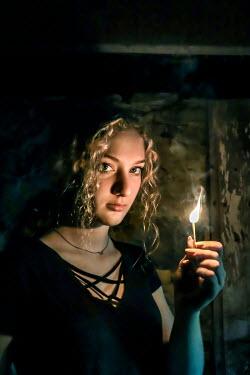 Stephen Carroll GIRL HOLDING MATCH IN DERELICT HOUSE Women