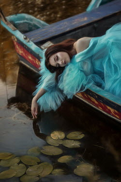 Beata Banach DAYDREAMING WOMAN IN BOAT ON LAKE Women