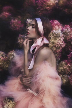 Beata Banach WOMAN IN PINK CHIFFON BY FLOWERS OUTDOORS Women