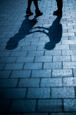 Mohamad Itani SHADOWS OF COUPLE HOLDING HANDS ON PAVEMENT Couples