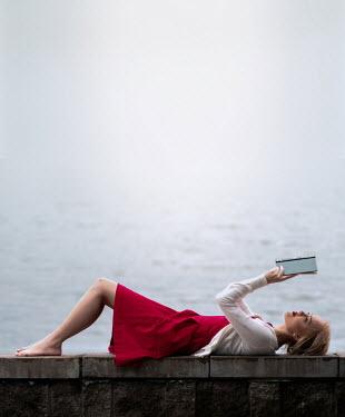 Elisabeth Ansley GIRL LYING BY SEA HOLDING BOOK Women