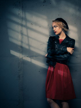 Elisabeth Ansley WOMAN IN LEATHER JACKET AND BERET IN TUNNEL Women