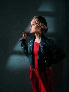 Elisabeth Ansley WOMA IN LEATHER JACKET BY WALL IN SHADOW Women