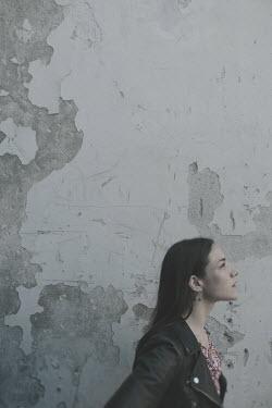 Giovan Battista D'Achille WOMAN IN LEATHER JACKET BY PEELING WALL Women