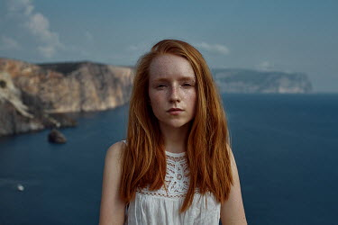 Irina Orwald GIRL WITH RED HAIR BY SEA WITH CLIFFS Women