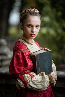 Dorota Gorecka TUDOR GIRL HOLDING BOOK IN GARDEN Women