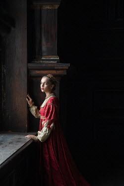 Dorota Gorecka TUDOR GIRL STANDING BY WINDOW INDOORS Women