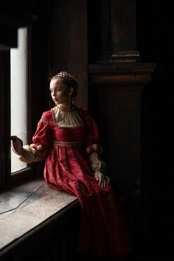 Dorota Gorecka MEDIEVAL WOMAN SITTING BY WINDOW INDOORS Women