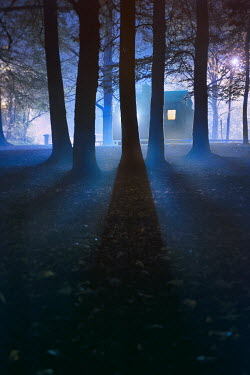 Lee Avison house with window light at night in fog