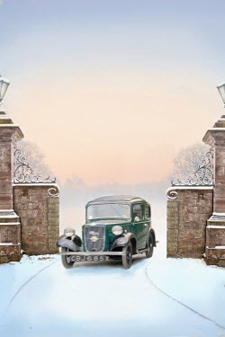 Lee Avison vintage car driving through a gateway in snow Cars