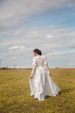 Joanna Czogala HISTORICAL WOMAN IN WHITE STANDING IN FIELD Women