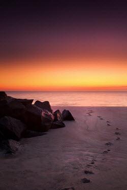 Lisa Bonowicz FOOTPRINTS ON SANDY BEACH AT SUNSET Seascapes/Beaches