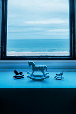 Stephen Mulcahey THREE MINIATURE ROCKING HORSES IN WINDOW BY SEA Miscellaneous Objects
