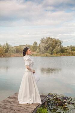Joanna Czogala HISTORICAL WOMAN ON JETTY BY LAKE Women
