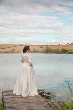 Joanna Czogala HISTORICAL WOMAN ON JETTY BY LAKE IN SUMMER Women