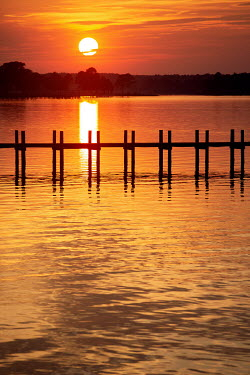 Michael Nelson EMPTY LANDING STAGE ON LAKE AT SUNSET Lakes/Rivers