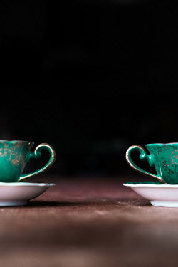 Maria Petkova CLOSE UP OF TWO GREEN TEACUPS Miscellaneous Objects