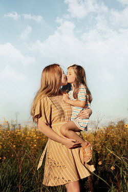 Buffy Cooper WOMAN KISSING DAUGHTER IN SUMMERY FIELD Children