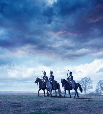 Stephen Mulcahey NAPOLEONIC SOLDIERS ON HORSES IN FIELD AT DUSK Groups/Crowds