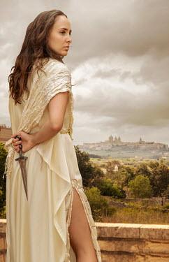 Stephen Mulcahey A roman princess in a palace garden holding a knife Women