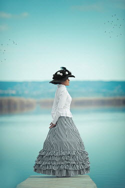 Ildiko Neer Historical woman standing on jetty