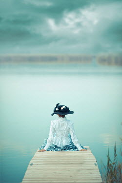 Ildiko Neer Historical woman sitting on jetty