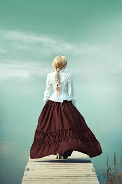 Ildiko Neer Historical woman walking on jetty