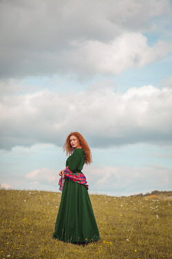 Joanna Czogala Woman with green dress and scarf in field