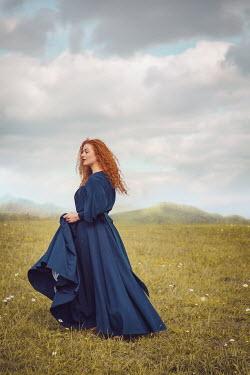 Joanna Czogala Woman with blue dress in field