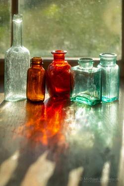 Michael Nelson coloured bottles on windowsill