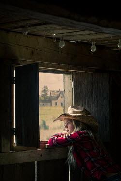 Robin Macmillan Girl in straw hat looking out barn window