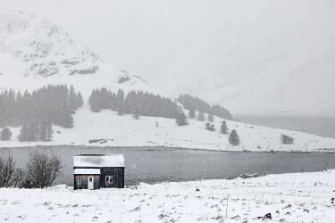 Evelina Kremsdorf Shack by snowy mountain in Lofoten, Norway Houses