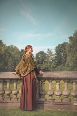 Joanna Czogala Woman in Victorian shawl by stone banister