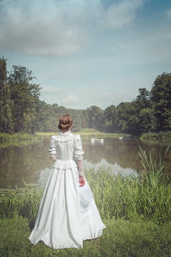 Joanna Czogala Young woman in white dress by pond