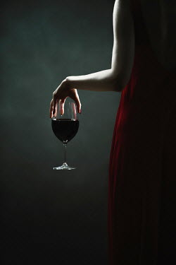 Magdalena Russocka close up of woman in red dress holding glass of wine