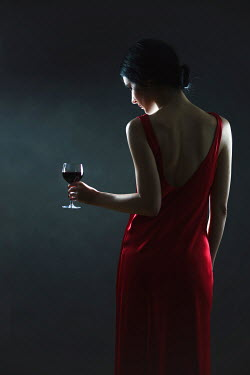 Magdalena Russocka woman in red dress holding glass of wine