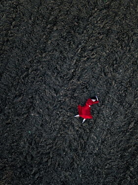 Magdalena Russocka aerial view of woman lying down on field