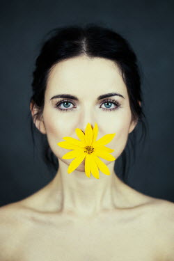 Magdalena Russocka woman with yellow flower in mouth