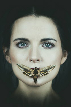 Magdalena Russocka close up of woman with moth on mouth